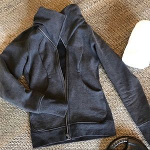 Lululemon gray zip up jacket with thumb holes.